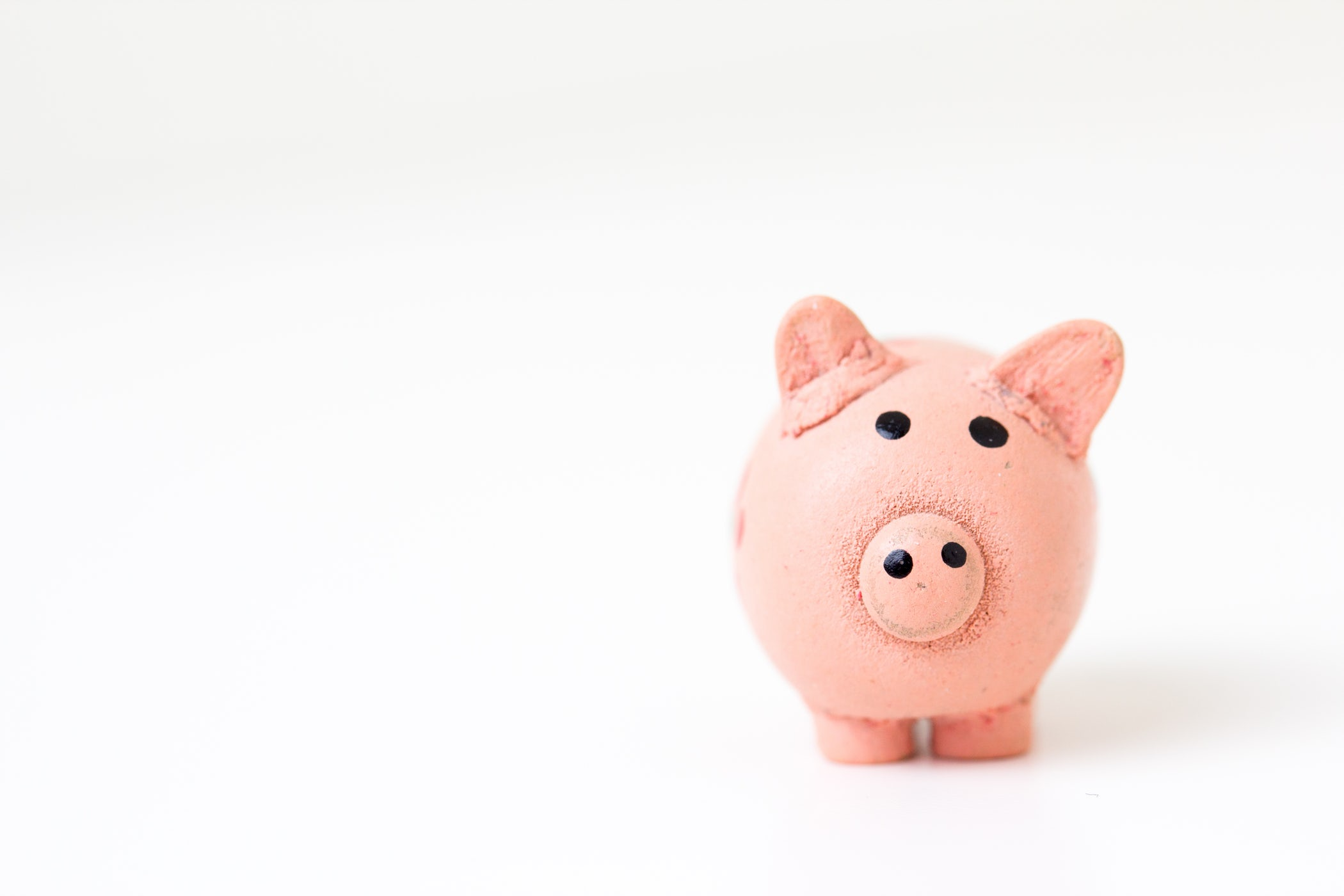 Piggy bank background image for a Danville Financial Advisor Firm
