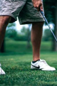 person golfing after retirement planning