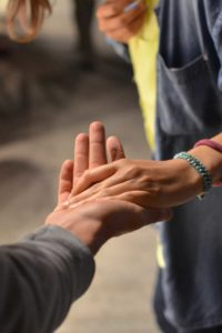 Hand in hand to represent charitable planning