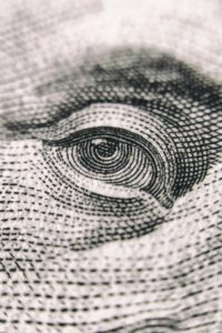 Closeup of eye on money for tax planning