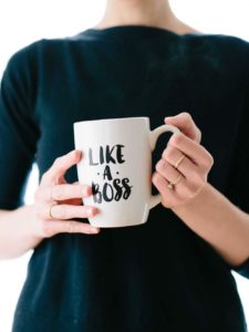 woman holding like a boss coffee mug representing choice in financial planners