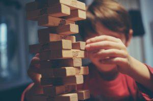special needs child playing jenga