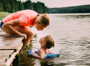 Mother and daughter swimming to represent passing wealth to kids