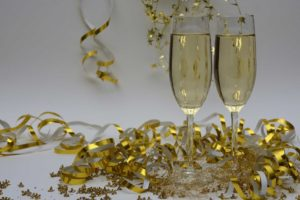 new years champagne flutes as a reminder to set financial goals