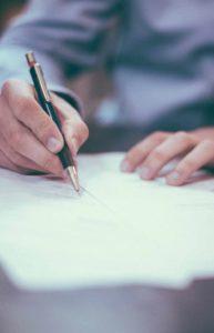 A Danville, CA financial advisor reviewing financial documents