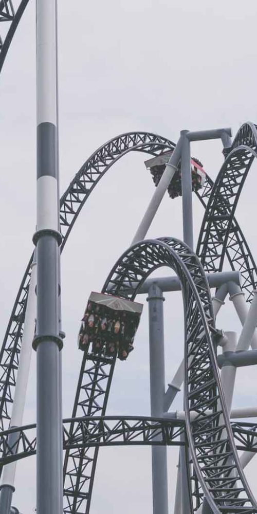Rollercoaster representing how scary it is to meet with a financial advisor
